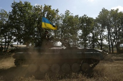 A Ukrainian armoured vehicle drives on a field near the eastern Ukrainian town of Pervomaysk