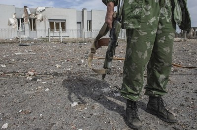 A pro-Russian rebel holds his rifle at the destroyed airport in Luhanks, eastern Ukraine