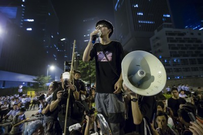 Wong, leader of the student movement, delivers a speech,outside the offices of Hong Kong's Chief Executive Leung Chun-ying in Hong Kong